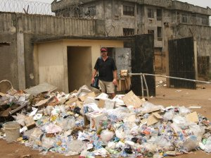 Scott Paschal, ICTA Founder, on trash heap inside Nigerian National Sports Complex