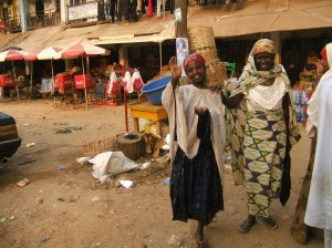 Local Benin City beggar girl with her blind Grandmother in the market