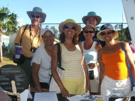 Fun group of people visiting International Christian Tennis Association exhibitor's booth.